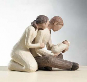 Figure of Mother and Father Embracing a Newborn | CoppinsGifts.com